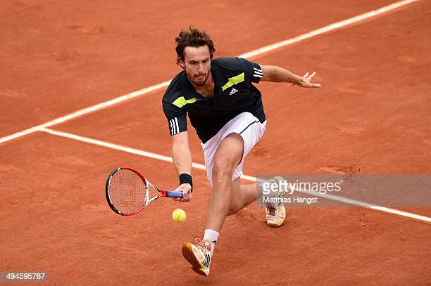 Ernests Gulbis of Latvia returns a shot during his men's singles match against Radek Stepanek of Czech Republic on day six of the French Open at...