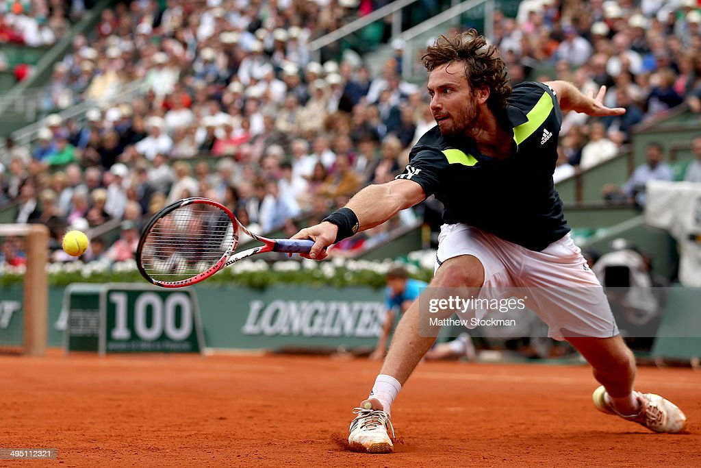 <a gi-track='captionPersonalityLinkClicked' href=/galleries/search?phrase=Ernests+Gulbis&family=editorial&specificpeople=4095282 ng-click='$event.stopPropagation()'>Ernests Gulbis</a> of Latvia returns a shot in his men's singles match against Roger Federer of Switzerland on day eight of the French Open at Roland Garros on June 1, 2014 in Paris, France.