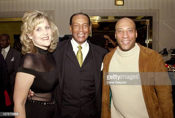 Ernie Banks Annie Nelson and Byron Allen pose at the Childrens Miracle Network and Childrens Hospital Celebration of Champions fundraiser held at the...