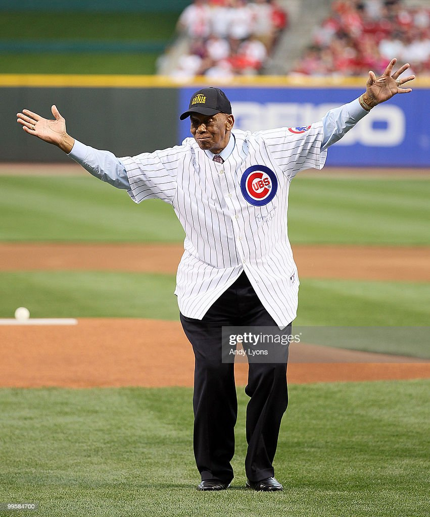 Ernie Banks waves to the crowd after throwing out the first pitch before the Gillette Civil Rights Game between the Cincinnati Reds and the St. Louis Cardinals at Great American Ball Park on May 15, 2010 in Cincinnati, Ohio.