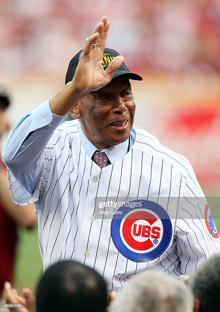 Ernie Banks waves to the crowd before throwing out the first pitch before the Gillette Civil Rights Game between the Cincinnati Reds and the St. Louis Cardinals at Great American Ball Park on May 15, 2010 in Cincinnati, Ohio.