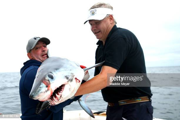 Ernie Bill and Jay Houser hold the shortfin mako shark they caught during the North Atlantic Monster Shark Tournament on July 14 2017 in New Bedford...