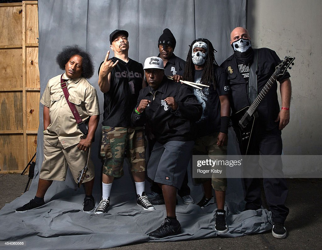 Ernie C , <a gi-track='captionPersonalityLinkClicked' href=/galleries/search?phrase=Ice-T&family=editorial&specificpeople=213017 ng-click='$event.stopPropagation()'>Ice-T</a> and members of Body Count pose for portrait before their performance onstage during day 1 of the AFROPUNK festival at Commodore Barry Park on August 23, 2014 in Brooklyn, New York.