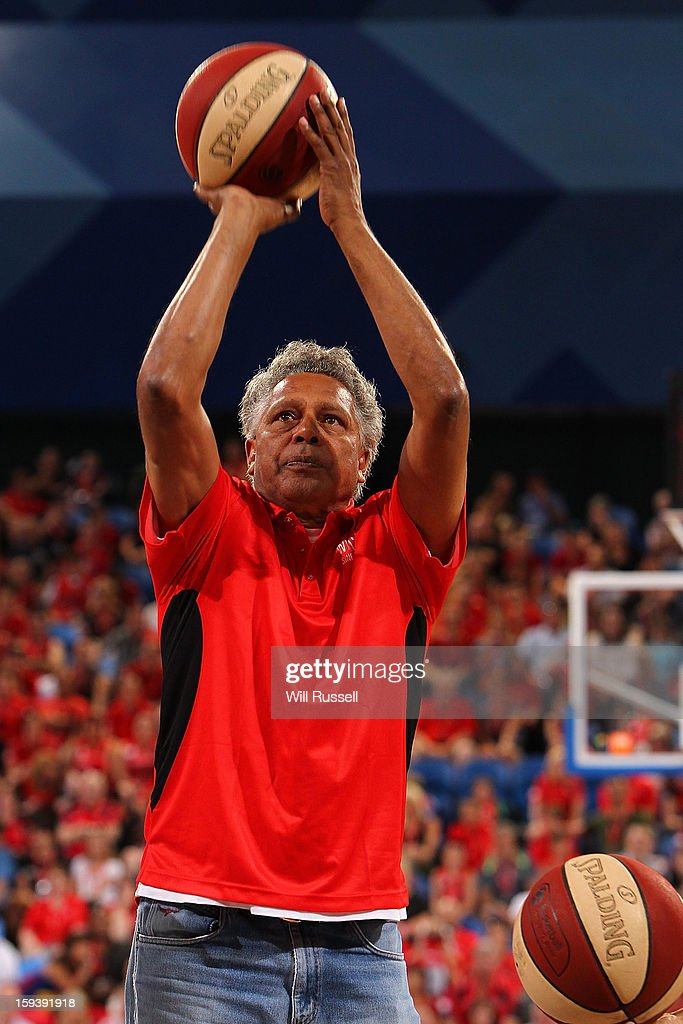 <a gi-track='captionPersonalityLinkClicked' href=/galleries/search?phrase=Ernie+Dingo&family=editorial&specificpeople=2218660 ng-click='$event.stopPropagation()'>Ernie Dingo</a> shoots on basket during the break during the round 14 NBL match between the Perth Wildcats and the Melbourne Tigers at Perth Arena on January 13, 2013 in Perth, Australia.