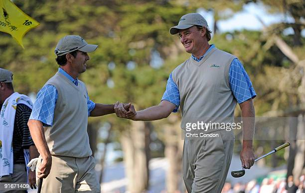 Ernie Els and Mike Weir of the International Team celebrate a birdie on during the second round fourball matches for The Presidents Cup at Harding...
