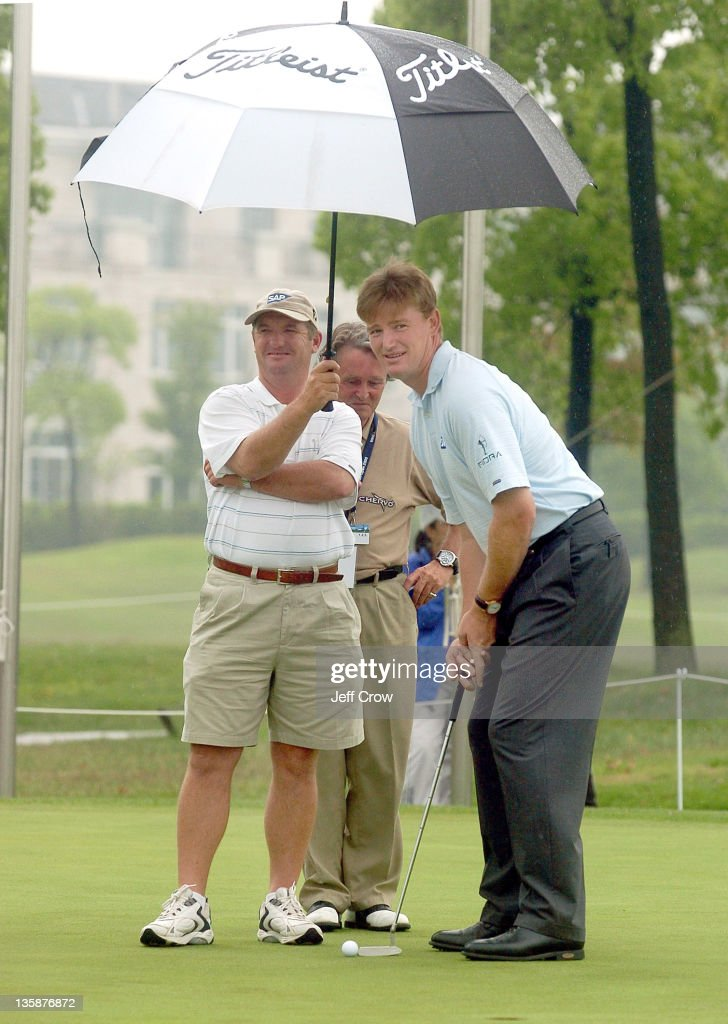 Ernie Els from South Africa waits and laughs waiting for the rain to clear to start RD4. Els leads by 5 strokes at 19 under par