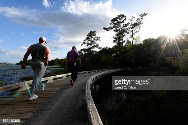 Ernie Els of South Africa and Alex Noren of Sweden walks to the 11th tee during round two of the Wells Fargo Championship at Eagle Point Golf Club on...