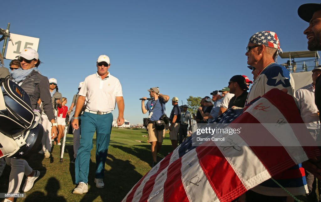Ernie Els of South Africa and Captains Assistant of the International Team walks onto the course during the Thursday foursomes matches during the first round of the Presidents Cup at Liberty National Golf Club on September 28, 2017, in Jersey City, New Jersey.