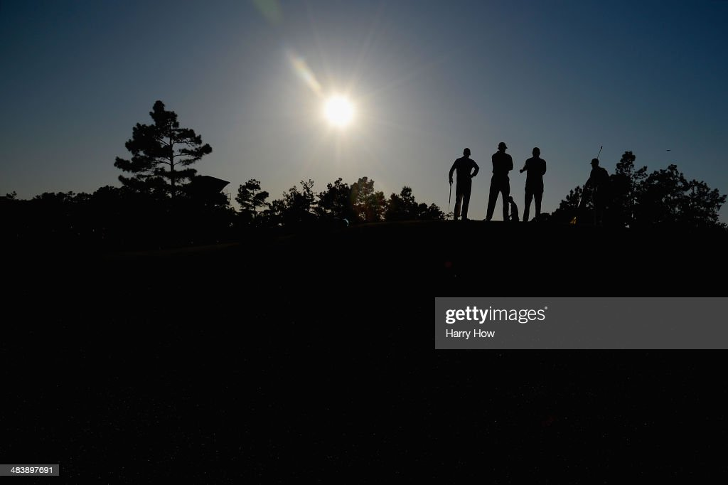 <a gi-track='captionPersonalityLinkClicked' href=/galleries/search?phrase=Ernie+Els&family=editorial&specificpeople=162688 ng-click='$event.stopPropagation()'>Ernie Els</a> of South Africa and his caddie Colin Byrne stand on the 17th green with caddie Mark Fulcher during the first round of the 2014 Masters Tournament at Augusta National Golf Club on April 10, 2014 in Augusta, Georgia.