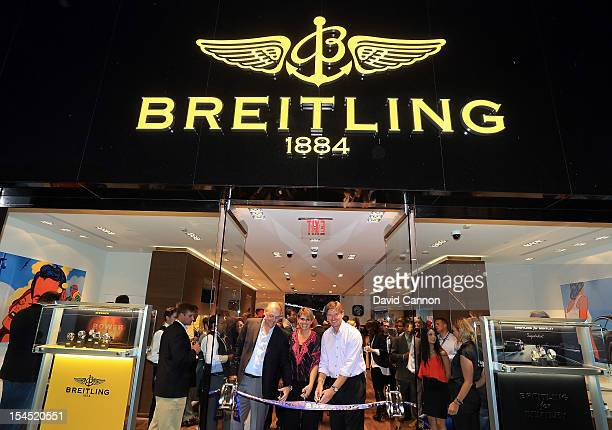 Ernie Els of South Africa and his wife Liezl Els cut the ribbon of the Breitling Store with Thierry Prissert the President of Breitling USA in The...