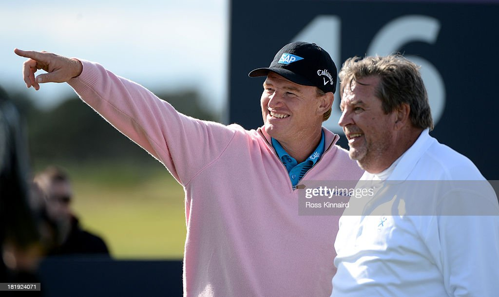 <a gi-track='captionPersonalityLinkClicked' href=/galleries/search?phrase=Ernie+Els&family=editorial&specificpeople=162688 ng-click='$event.stopPropagation()'>Ernie Els</a> of South Africa and Johann Rupert the Chairman of Richemont during the first round of the 2013 Alfred Dunhill Links Championship at the Carnoustie Golf Links on September 26, 2013 in Carnoustie, Scotland.