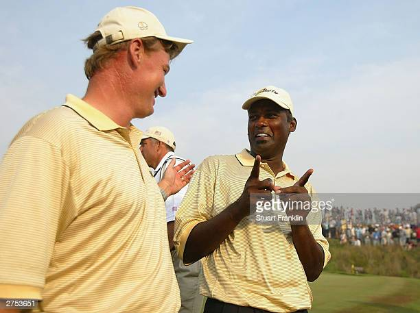 Ernie Els of South Africa and Vijay Singh of Fiji after the match against Tiger Woods and Charles Howell III of USA during the second round of...