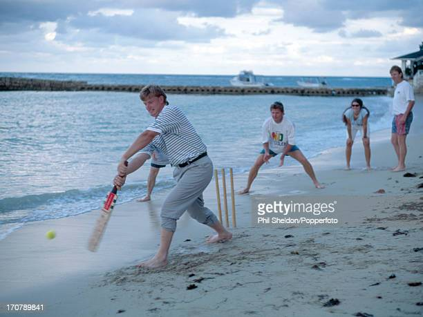 Ernie Els of South Africa batting with Nick Price as wicketkeeper in a cricket match on the beach during the Johnnie Walker World Golf Championship...