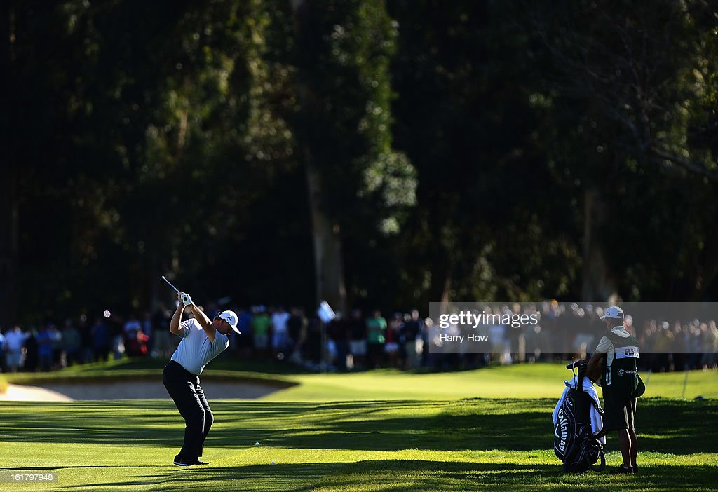 Ernie Els of South Africa hits a second shot on the first hole during the third round of the Northern Trust Open at the Riviera Country Club on February 16, 2013 in Pacific Palisades, California.