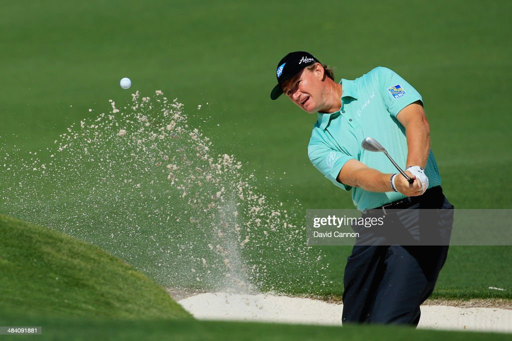 Ernie Els of South Africa hits a shot out of the bunker on the second hole during the second round of the 2014 Masters Tournament at Augusta National Golf Club on April 11, 2014 in Augusta, Georgia.