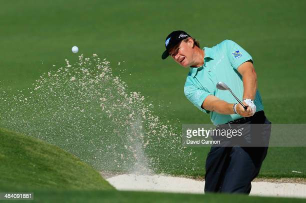 Ernie Els of South Africa hits a shot out of the bunker on the second hole during the second round of the 2014 Masters Tournament at Augusta National...