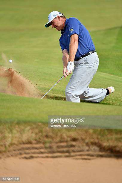 Ernie Els of South Africa hits from a bunker on the 16th hole during the first round on day one of the 145th Open Championship at Royal Troon on July...