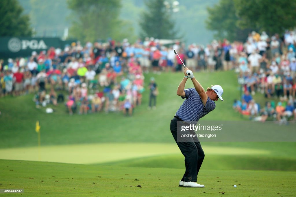 <a gi-track='captionPersonalityLinkClicked' href=/galleries/search?phrase=Ernie+Els&family=editorial&specificpeople=162688 ng-click='$event.stopPropagation()'>Ernie Els</a> of South Africa hits his second shot on the 12th hole during the final round of the 96th PGA Championship at Valhalla Golf Club on August 10, 2014 in Louisville, Kentucky.