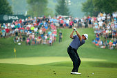 Ernie Els of South Africa hits his second shot on the 12th hole during the final round of the 96th PGA Championship at Valhalla Golf Club on August...