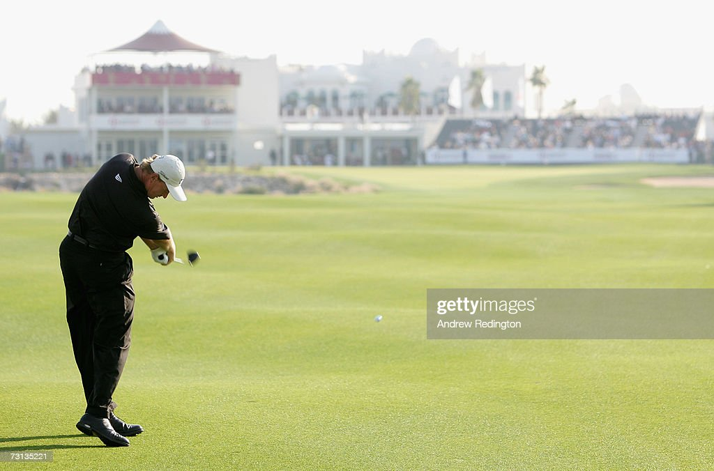 Ernie Els of South Africa hits his second shot on the 18th hole during the final round of The Commercial Bank Qatar Masters at Doha Golf Club on...