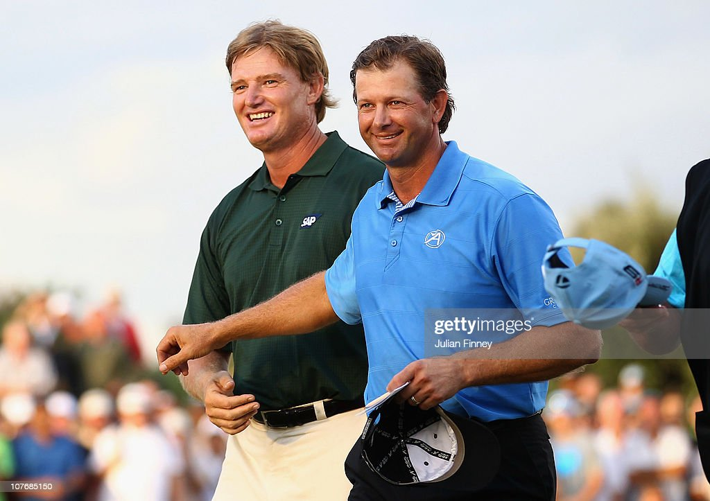 <a gi-track='captionPersonalityLinkClicked' href=/galleries/search?phrase=Ernie+Els&family=editorial&specificpeople=162688 ng-click='$event.stopPropagation()'>Ernie Els</a> of South Africa is congratulated by <a gi-track='captionPersonalityLinkClicked' href=/galleries/search?phrase=Retief+Goosen&family=editorial&specificpeople=201918 ng-click='$event.stopPropagation()'>Retief Goosen</a> of South Africa after the final round during the South African Open Golf Championship at the Durban Country Club on December 19, 2010 in Durban, South Africa.