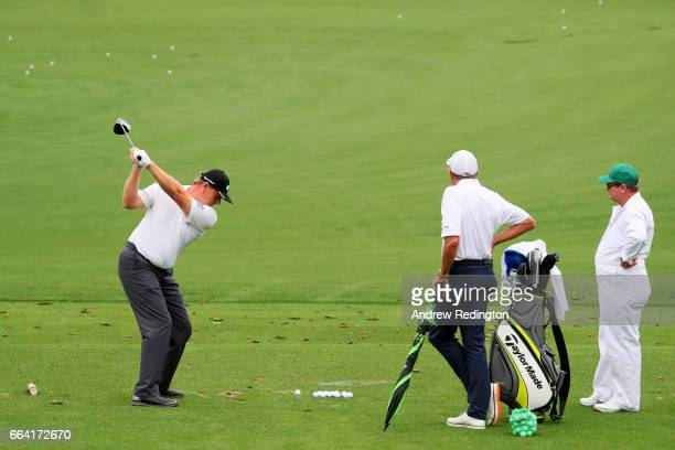 Ernie Els of South Africa is watched by golf instructor David Leadbetter and caddie Rikki Roberts during a practice round prior to the start of the...