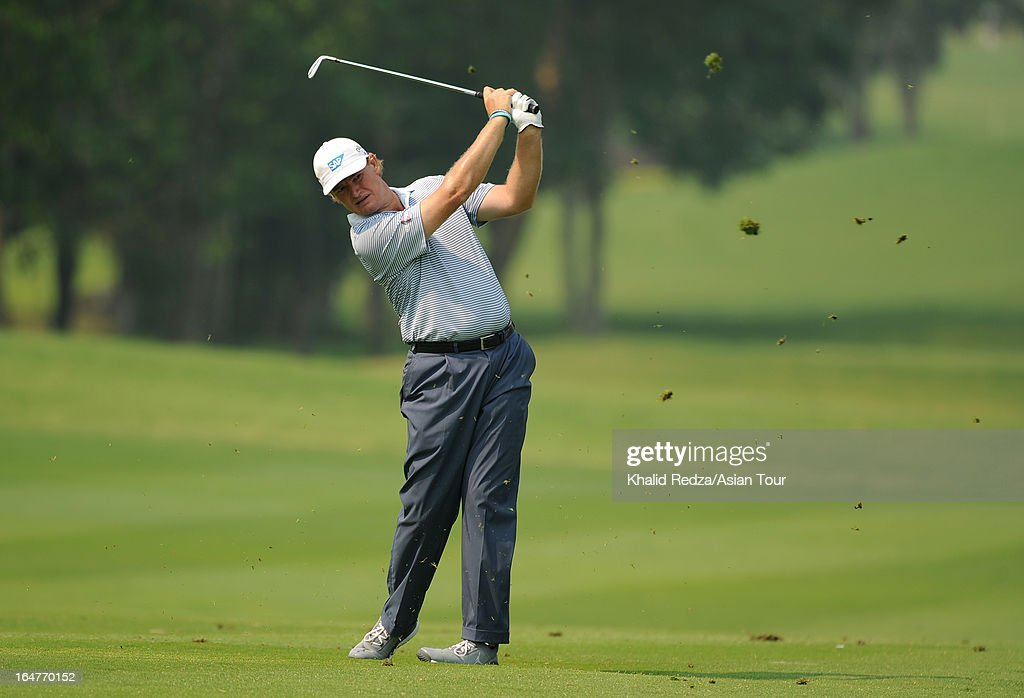Ernie Els of South Africa plays a shot during round one of the Chiangmai Golf Classic at Alpine Golf Resort-Chiangmai on March 28, 2013 in Chiang Mai, Thailand.