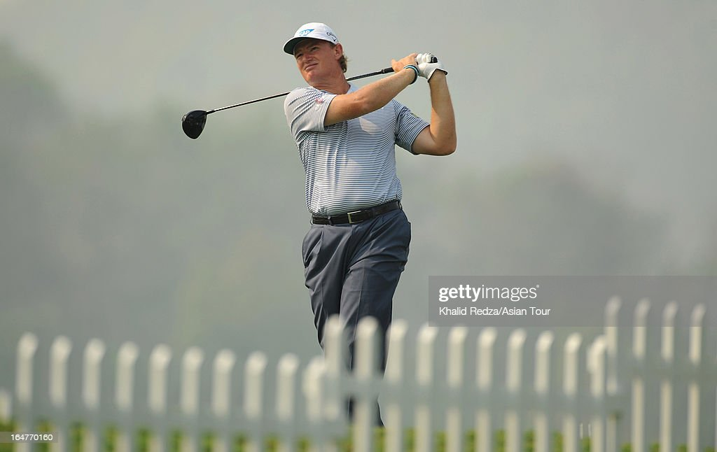 <a gi-track='captionPersonalityLinkClicked' href=/galleries/search?phrase=Ernie+Els&family=editorial&specificpeople=162688 ng-click='$event.stopPropagation()'>Ernie Els</a> of South Africa plays a shot during round one of the Chiangmai Golf Classic at Alpine Golf Resort-Chiangmai on March 28, 2013 in Chiang Mai, Thailand.