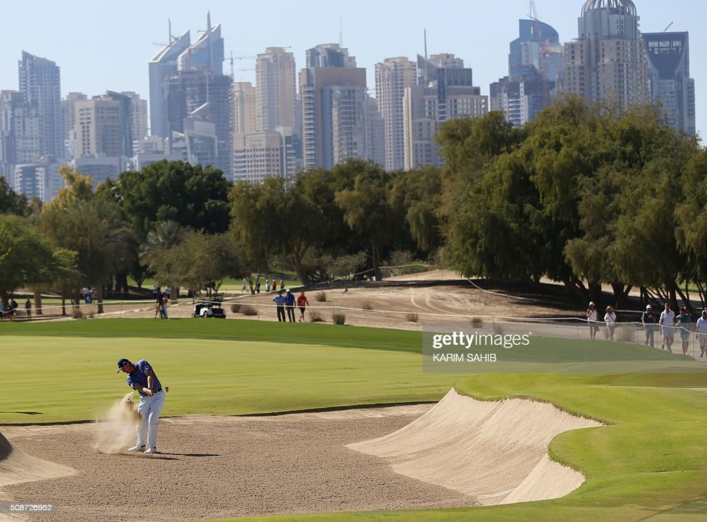 Ernie Els of South Africa plays a shot during the third round of the 2016 Dubai Desert Classic at the Emirates Golf Club in Dubai on February 6, 2016. / AFP / KARIM SAHIB