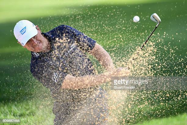 Ernie Els of South Africa plays a shot from the bunker during the continuation of the weather delayed first round of the Porsche European Open at...