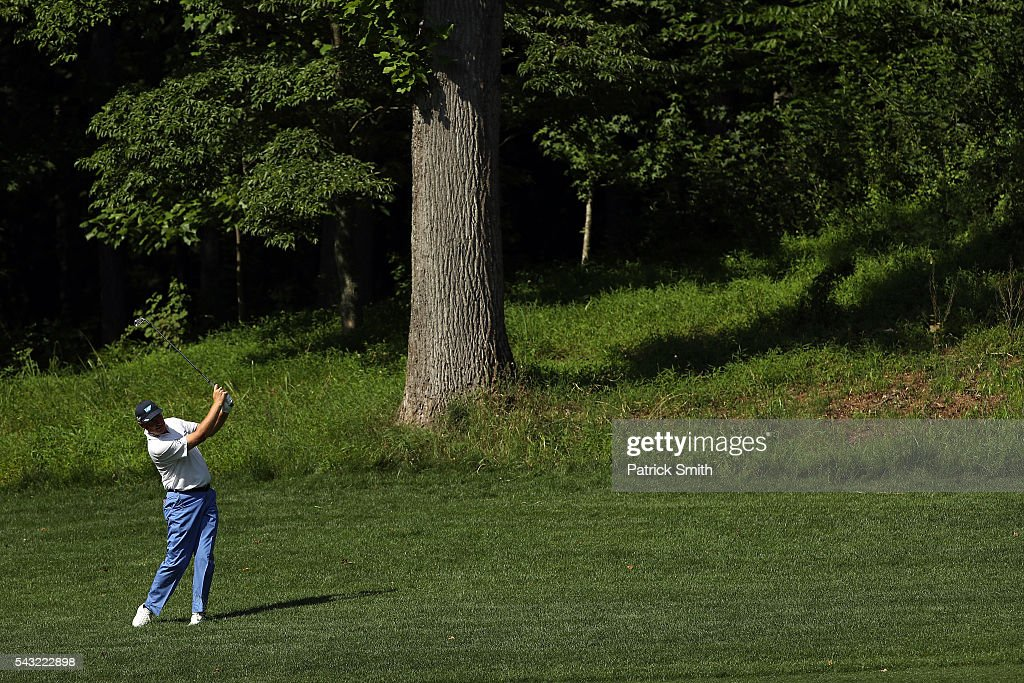 <a gi-track='captionPersonalityLinkClicked' href=/galleries/search?phrase=Ernie+Els&family=editorial&specificpeople=162688 ng-click='$event.stopPropagation()'>Ernie Els</a> of South Africa plays a shot on the 11th hole during the final round of the Quicken Loans National at Congressional Country Club on June 26, 2016 in Bethesda, Maryland.