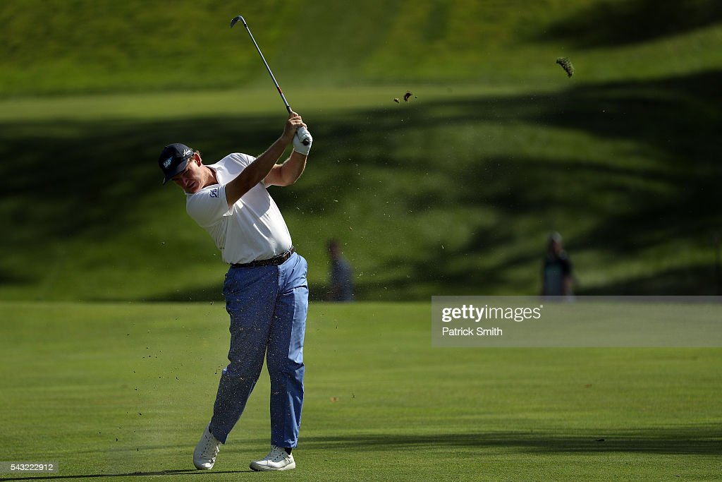 <a gi-track='captionPersonalityLinkClicked' href=/galleries/search?phrase=Ernie+Els&family=editorial&specificpeople=162688 ng-click='$event.stopPropagation()'>Ernie Els</a> of South Africa plays a shot on the 12th hole during the final round of the Quicken Loans National at Congressional Country Club on June 26, 2016 in Bethesda, Maryland.