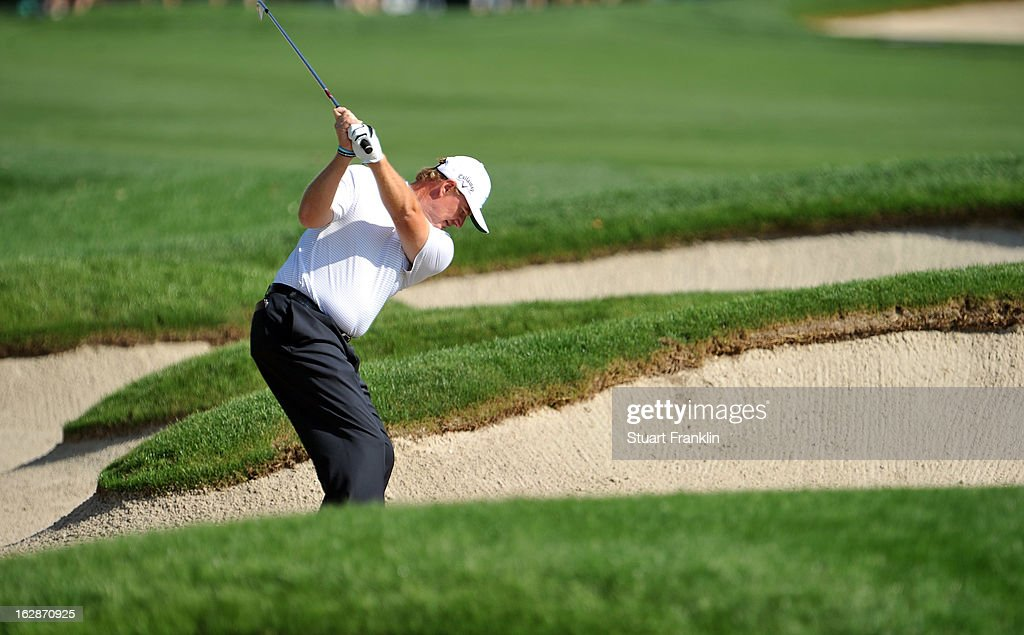 <a gi-track='captionPersonalityLinkClicked' href=/galleries/search?phrase=Ernie+Els&family=editorial&specificpeople=162688 ng-click='$event.stopPropagation()'>Ernie Els</a> of South Africa plays a shot on the 13th hole during the first round of the Honda Classic on February 28, 2013 in Palm Beach Gardens, Florida.