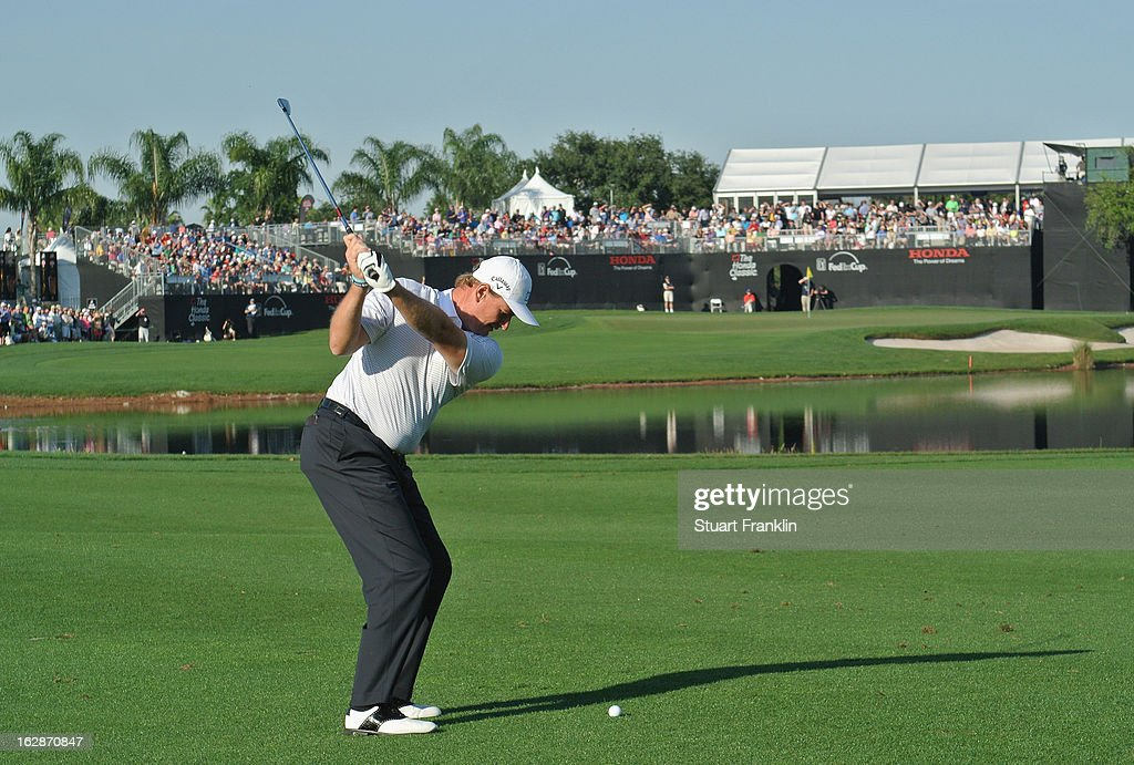 <a gi-track='captionPersonalityLinkClicked' href=/galleries/search?phrase=Ernie+Els&family=editorial&specificpeople=162688 ng-click='$event.stopPropagation()'>Ernie Els</a> of South Africa plays a shot on the 16th hole during the first round of the Honda Classic on February 28, 2013 in Palm Beach Gardens, Florida.