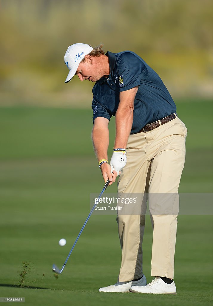 Ernie Els of South Africa plays a shot on the second play off hole during the second round of the World Golf Championships - Accenture Match Play Championship at The Golf Club at Dove Mountain on February 20, 2014 in Marana, Arizona.
