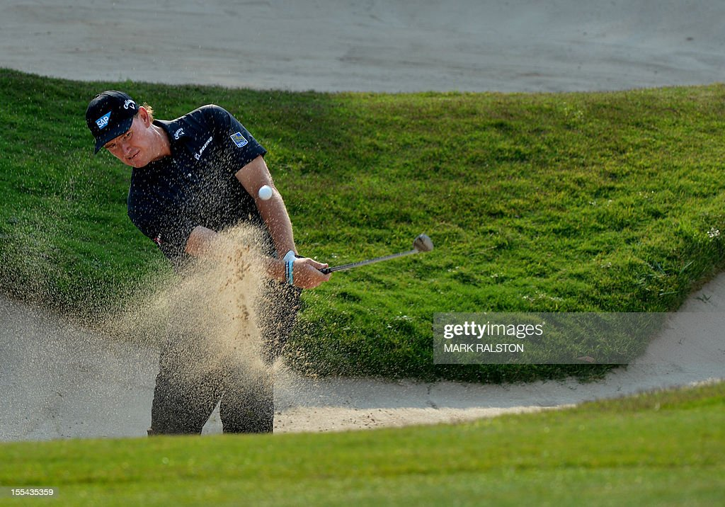Ernie Els of South Africa plays from the bunker at the 15th hole before finishing tied for second during the WGC-HSBC Champions tournament held on the Olazabal Course at the Mission Hill Golf Club in Dongguan on November 4, 2012. Els finished on 19 under par. AFP PHOTO/Mark RALSTON