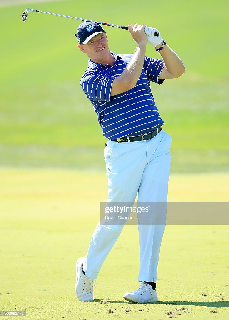 Ernie Els of South Africa plays his second shot at the par 4, first hole during the third round of the 2016 Omega Dubai Desert Classic on the Majlis Course at the Emirates Golf Club on February 6, 2016 in Dubai, United Arab Emirates.