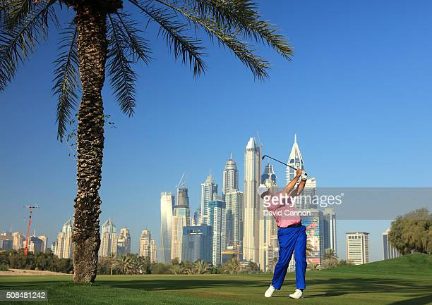 Ernie Els of South Africa plays his second shot at the par 5 13th hole during the second round of the 2016 Omega Dubai Desert Classic on the Majlis...