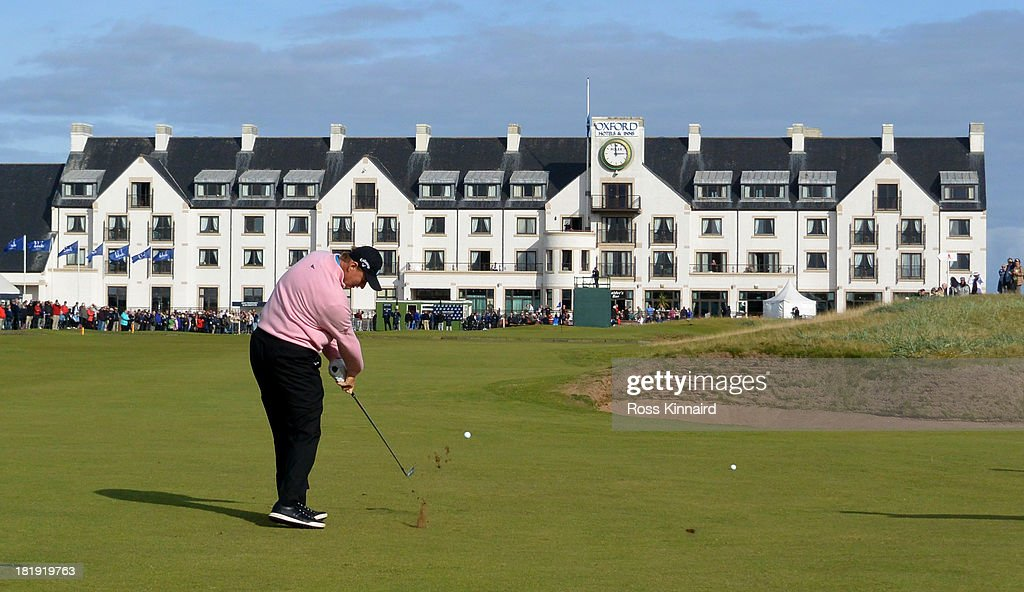<a gi-track='captionPersonalityLinkClicked' href=/galleries/search?phrase=Ernie+Els&family=editorial&specificpeople=162688 ng-click='$event.stopPropagation()'>Ernie Els</a> of South Africa plays his second shot to the par four 18th hole during the first round of the 2013 Alfred Dunhill Links Championship at the Carnoustie Golf Links on September 26, 2013 in Carnoustie, Scotland.