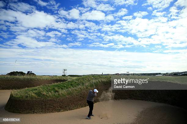 Ernie Els of South Africa plays out from the Hell bunker on the 14th hole during the final practice round prior to the 2014 Alfred Dunhill Links...
