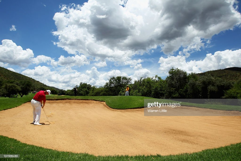 Ernie Els of South Africa plays out the third fairway bunker during the final round of the 2010 Nedbank Golf Challenge at the Gary Player Country...