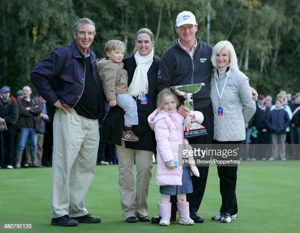 Ernie Els of South Africa poses with the trophy with his father Neels son Ben wife Liezl daughter Samantha and mother Hettie after winning the final...