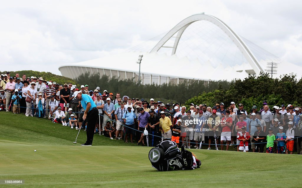 <a gi-track='captionPersonalityLinkClicked' href=/galleries/search?phrase=Ernie+Els&family=editorial&specificpeople=162688 ng-click='$event.stopPropagation()'>Ernie Els</a> of South Africa putts on the first green during the third round of the Volvo Golf Champions at Durban Country Club on January 12, 2013 in Durban, South Africa.