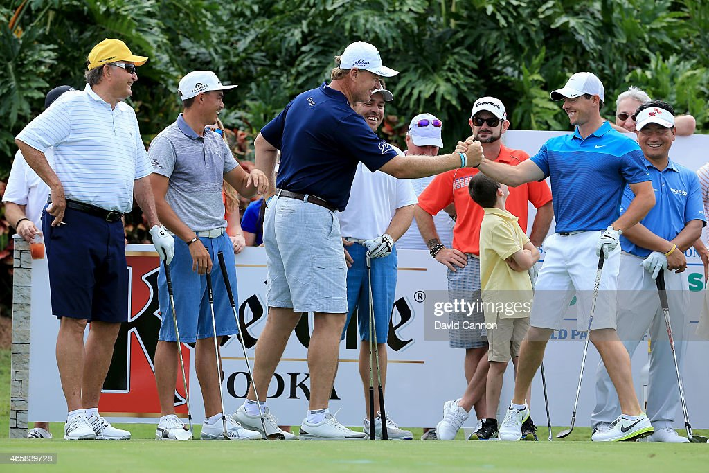 Ernie Els of South Africa reacting with the World's Number One Golfer Rory McIlroy of Northern Ireland during the $2 Million Kettle One Vodka Challenge on the 120 yards par 3, 19th hole at The Old Palm CC during the Ernie Els Els for Autism pro-am on March 9, 2015 in West Palm Beach, Florida.