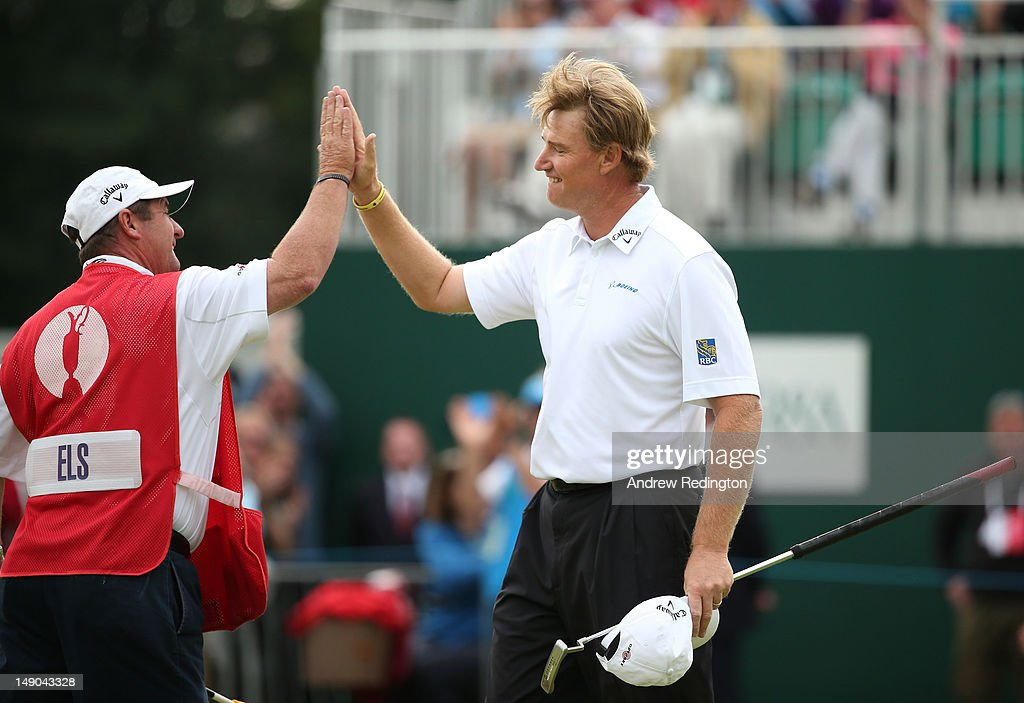 Ernie Els of South Africa reacts with his caddie Ricci Roberts to a birdie putt on the 18th hole during the final round of the 141st Open Championship at Royal Lytham & St. Annes Golf Club on July 22, 2012 in Lytham St Annes, England.