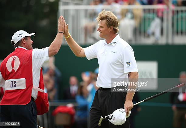 Ernie Els of South Africa reacts with his caddie Ricci Roberts to a birdie putt on the 18th hole during the final round of the 141st Open...