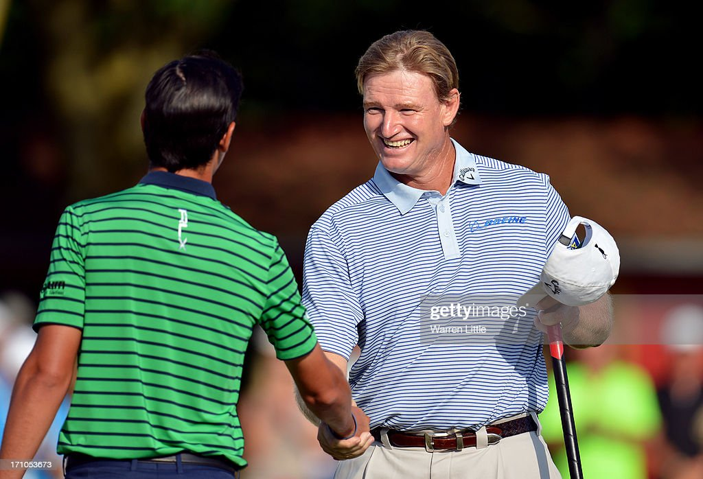 Ernie Els of South Africa shakes hands with Matteo Manassero of Italy on the 18th green during the second round of the BMW International Open at Golfclub Munchen Eichenried on June 21, 2013 in Munich, Germany.