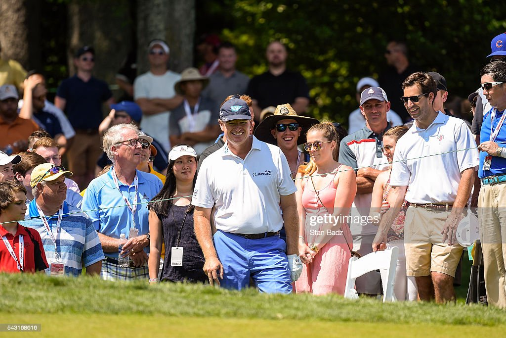 <a gi-track='captionPersonalityLinkClicked' href=/galleries/search?phrase=Ernie+Els&family=editorial&specificpeople=162688 ng-click='$event.stopPropagation()'>Ernie Els</a> of South Africa shares a laugh with fans before chipping to the fourth hole green during the final round of the Quicken Loans National at Congressional Country Club (Blue) on June 26, 2016 in Bethesda, Maryland.