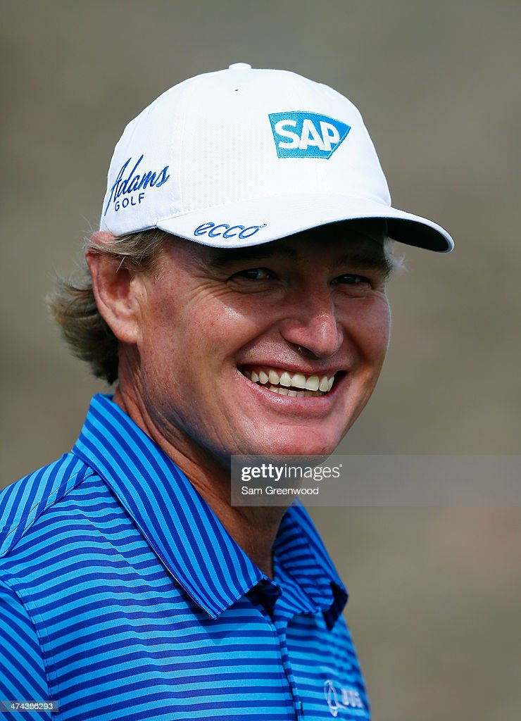 <a gi-track='captionPersonalityLinkClicked' href=/galleries/search?phrase=Ernie+Els&family=editorial&specificpeople=162688 ng-click='$event.stopPropagation()'>Ernie Els</a> of South Africa smiles following his victory over Jordan Spieth during the quarterfinal round of the World Golf Championships - Accenture Match Play Championship at The Golf Club at Dove Mountain on February 22, 2014 in Marana, Arizona.