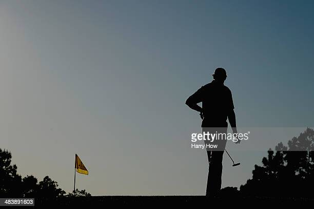 Ernie Els of South Africa stands on the 17th green during the first round of the 2014 Masters Tournament at Augusta National Golf Club on April 10...